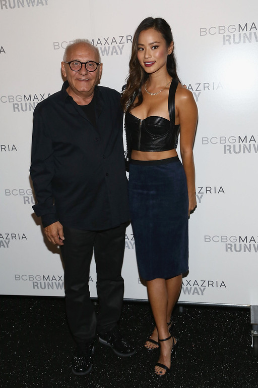 . Designer Max Azria (L) and actress Jamie Chung pose backstage at the BCBGMAXAZRIA Spring 2014 fashion show during Mercedes-Benz Fashion Week  at The Theatre at Lincoln Center on September 5, 2013 in New York City.  (Photo by Astrid Stawiarz/Getty Images for Mercedes-Benz Fashion Week)