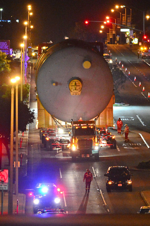 . Two huge 500,000 pound coke drums units were transported from King Harbor in Redondo Beach to Chevron refinery in El Segundo Wednesday and early Thursday morning, forcing the closure of Sepulveda Blvd.  The first drum makes its way up one of many rolling hills on Sepulveda Blvd through Manhattan Beach. 20130221 Photo by Steve McCrank / Staff Photographer
