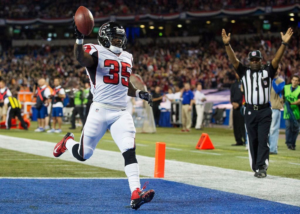 . Atlanta Falcons Antone Smith celebrates his touchdown against the Buffalo Bills during the first half of NFL action in Toronto, Sunday Dec. 1, 2013. (AP Photo/The Canadian Press, Mark Blinch)