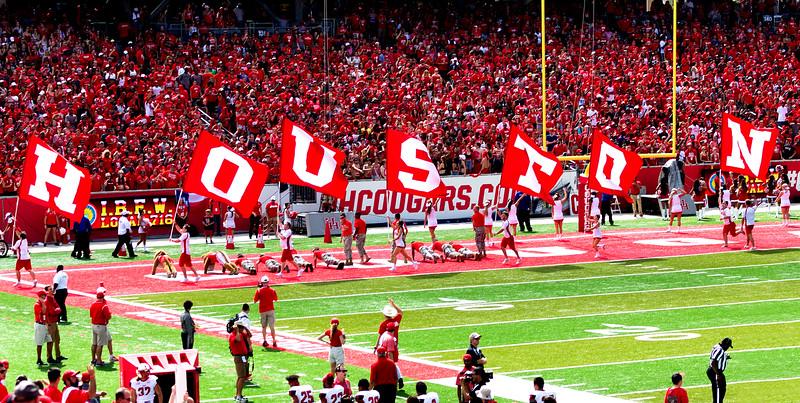 Running the cheerleader flags.