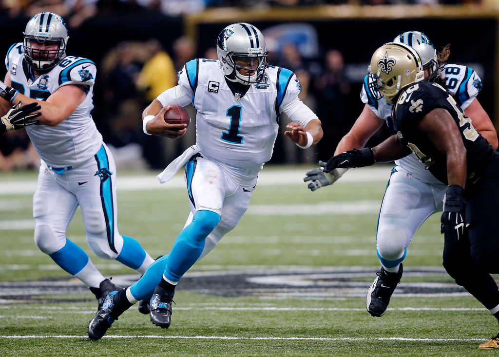 . In a Dec. 7, 2014, file photo Carolina Panthers quarterback Cam Newton (1) carries in the first half of an NFL football game against the New Orleans Saints in New Orleans.   Newton suffered fractures to his lower back in a two-car crash Tuesday, Dec. 9, 2014, and will spend the night in the hospital, a team spokesman said.    (AP Photo/Bill Haber, file)
