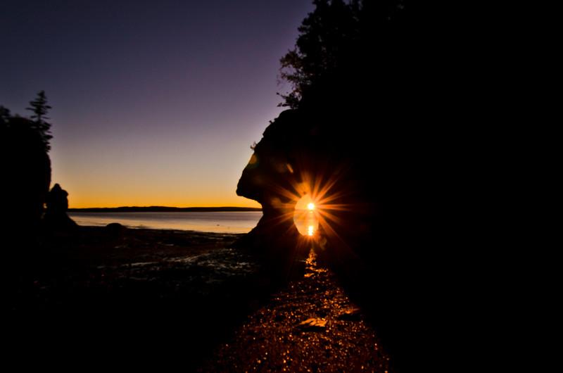 Sun peeking through Flower pot rocks, Hopewell Cape