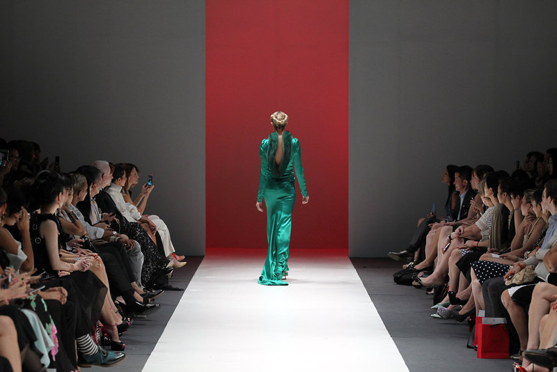 . A model showcases an outfit by New York based designer Carolina Herrera for \'The House of Herrera\'  Fall 2013 collection, in Singapore, Wednesday, May 15, 2013,  during the annual Fashion Festival held in the city-state. (AP Photo/Wong Maye-E)