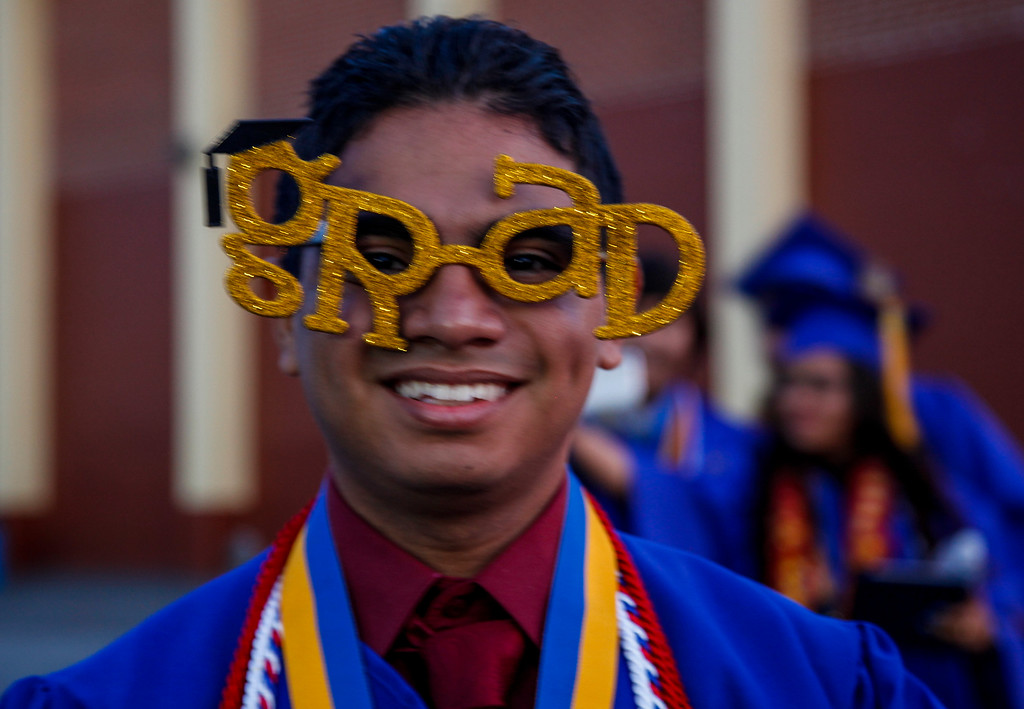 ". This \""Grad\"" is Juan Quintanilla, a Gold Seal Senior, with a 3.6 grade point average or better, at John H Francis Polytechnic High School Graduation Ceremony, Sun Valley, Calif., June 7, 2013. Photo: Lynn Levitt."