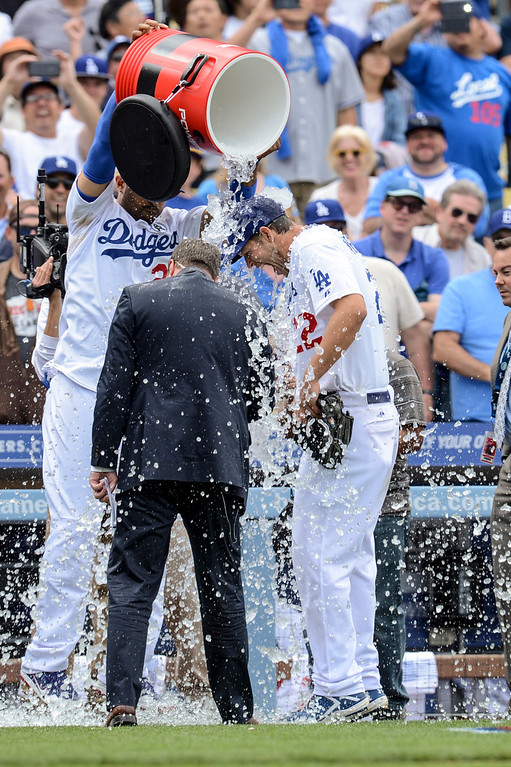 . Dodger\'s Clayton Kershaw gets doused with ice water after pitching the entire game and driving in the go ahead home run in the 8th inning during opening day at Dodger Stadium Monday.  Photo by David Crane/Los Angeles Daily News.
