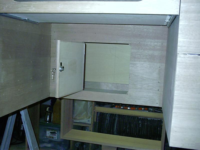 Hidden storage door open.