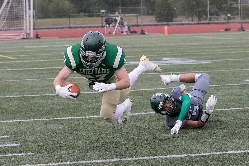 Nashoba Regional High School football played Grafton High School on Saturday, September 14, 2019. NRHS's #27 Jack Cahill is tripped up by GHS's Maxim Kogan. SENTINEL & ENTERPRISE/JOHN LOVE