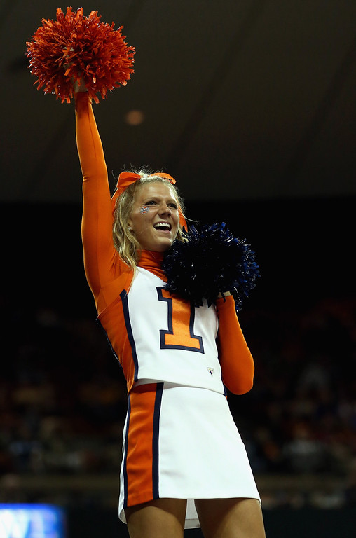 . AUSTIN, TX - MARCH 22:  A cheerleader of the Illinois Fighting Illini performs during the game against the Colorado Buffaloes during the second round of the 2013 NCAA Men\'s Basketball Tournament at The Frank Erwin Center on March 22, 2013 in Austin, Texas.  (Photo by Ronald Martinez/Getty Images)