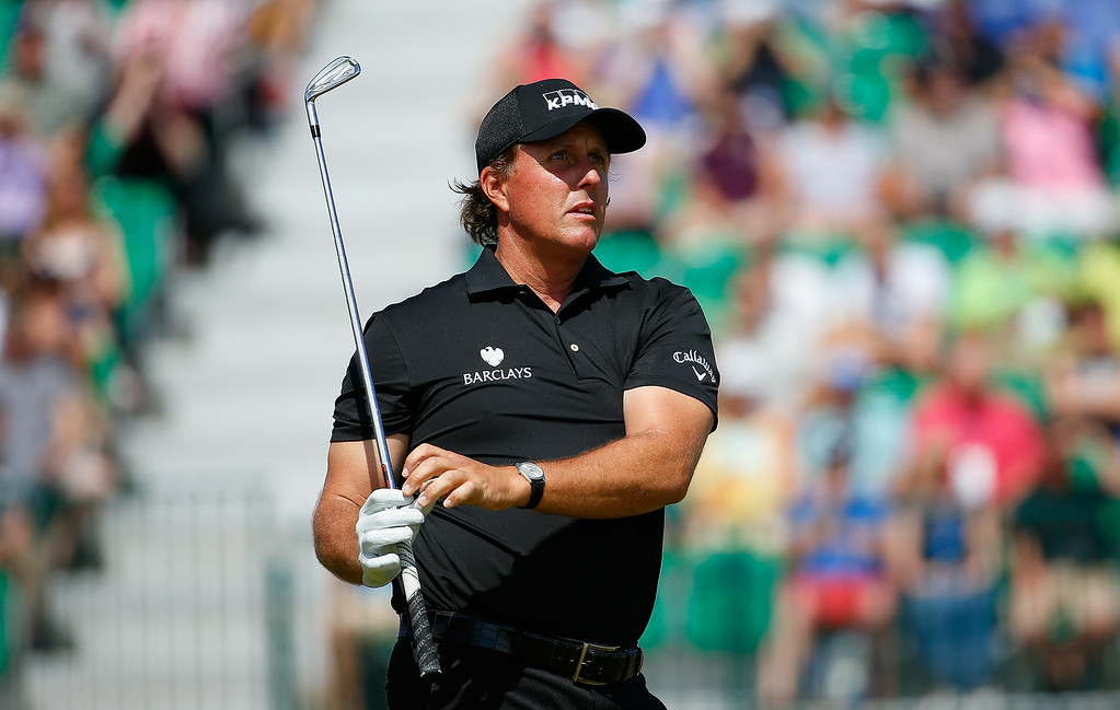 . Phil Mickelson of the United States watches his tee shot on the fourth hole during the final round of The 143rd Open Championship at Royal Liverpool on July 20, 2014 in Hoylake, England.  (Photo by Tom Pennington/Getty Images)