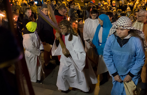 03/30/18 Wesley Bunnell | Staff Sacred Heart Church held a Stations of the Cross on Friday night featuring a procession up Broad St looping back around to finish at the church. The procession makes its way up the steps of Sacred Heart Church.