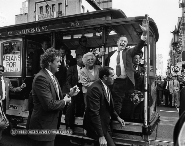 . San Francisco, CA September 14, 1988 - Candidate George Bush and wife Barbara wave from the cable car. (Matthew J. Lee / Oakland Tribune Staff Archives)