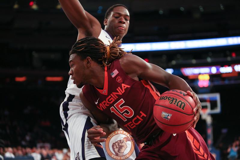 Virginia Tech's forward Chris Clarke (15) drives on a Washington defender in Madison Square Garden, Nov. 17, 2017. Virginia Tech won the game 103-79.