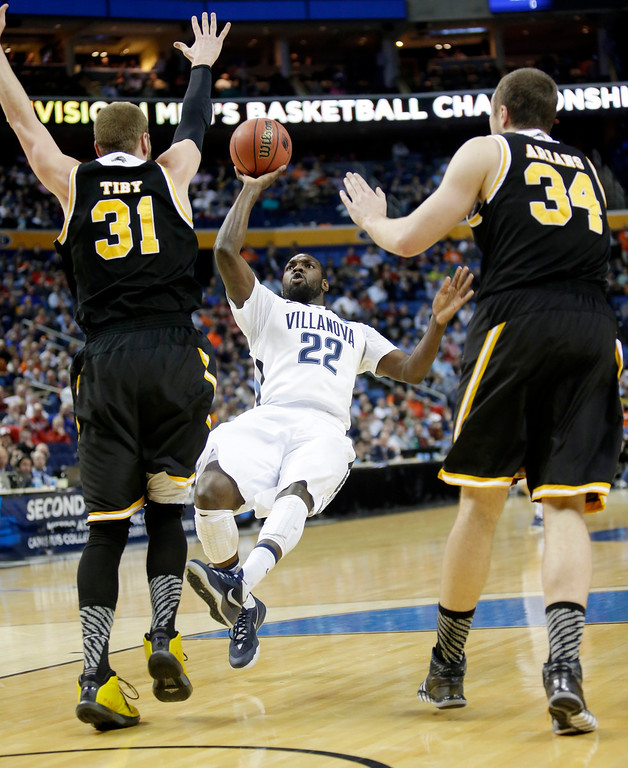. Villanova\'s JayVaughn Pinkston (22) shoots over Milwaukee\'s Matt Tiby (31) and Austin Arians (34) during the first half of a second-round game in the NCAA college basketball tournament in Buffalo, N.Y., Thursday, March 20, 2014. (AP Photo/Nick LoVerde)