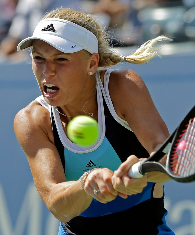 . Caroline Wozniacki, of Denmark, returns a shot to Ying-Ying Duan, of China, during the first round of the 2013 U.S. Open tennis tournament Tuesday, Aug. 27, 2013, in New York. (AP Photo/Mike Groll)