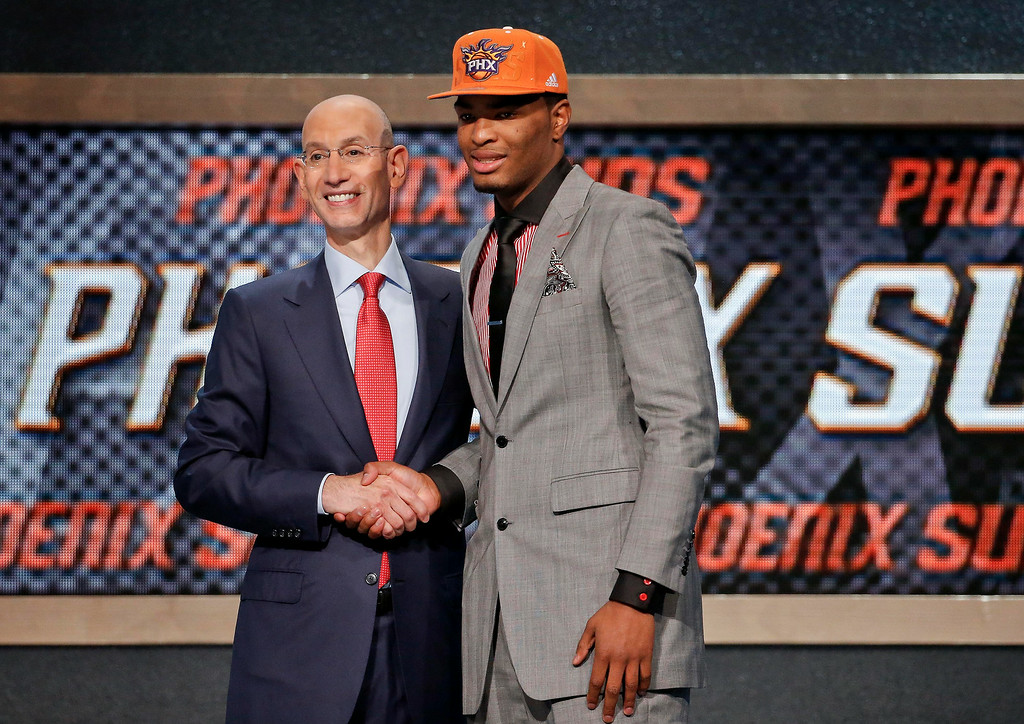 . North Carolina State\'s T.J. Warren, right, poses for a photo with NBA Commissioner Adam Silver after being selected 14th overall by the Phoenix Suns during the 2014 NBA draft, Thursday, June 26, 2014, in New York. (AP Photo/Jason DeCrow)
