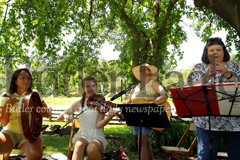 Deb Takacs, Elizabeth Nist, Janet Leise, Judy Jones and other musicians (not pictured) entertained guests at Early American Day at the Old Stone House in Slippery Rock. Seb Foltz/Butler Eagle