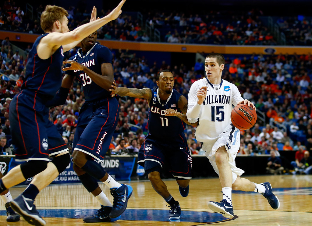 . BUFFALO, NY - MARCH 22: Ryan Arcidiacono #15 of the Villanova Wildcats drives to the basket as Ryan Boatright #11 of the Connecticut Huskies defends during the third round of the 2014 NCAA Men\'s Basketball Tournament at the First Niagara Center on March 22, 2014 in Buffalo, New York.  (Photo by Jared Wickerham/Getty Images)