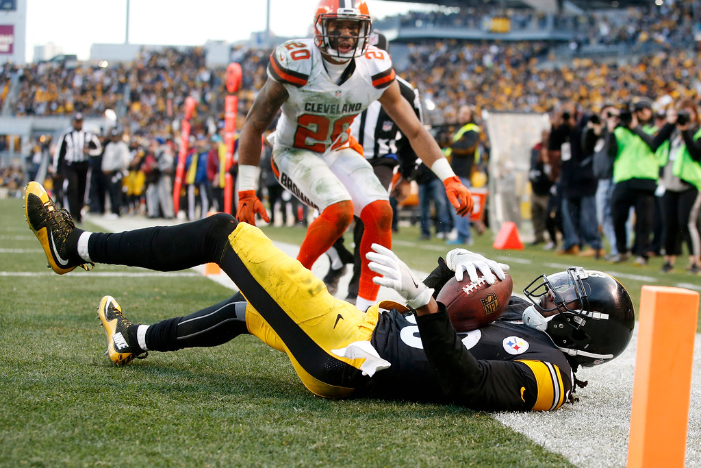. Pittsburgh Steelers wide receiver Cobi Hamilton (83) makes the game-winning touchdown catch during overtime of an NFL football game with Cleveland Browns strong safety Briean Boddy-Calhoun (20) defending in Pittsburgh, Sunday, Jan. 1, 2017. The Steelers won 27-24. (AP Photo/Jared Wickerham)