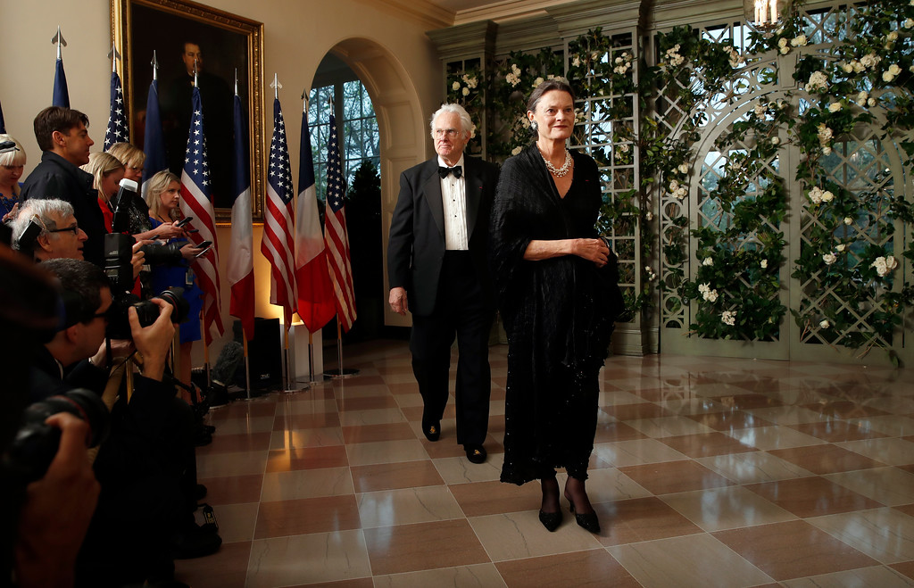 . David Hamilton and Catharine Hamilton arrives for a State Dinner with French President Emmanuel Macron and President Donald Trump at the White House, Tuesday, April 24, 2018, in Washington. (AP Photo/Alex Brandon)