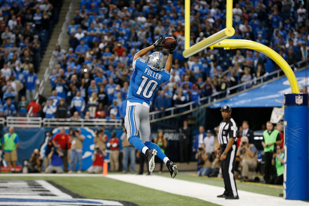 . Detroit Lions wide receiver Corey Fuller (10) catches the game tying touchdown during the second half of an NFL football game against the New Orleans Saints in Detroit, Sunday, Oct. 19, 2014. (AP Photo/Paul Sancya)