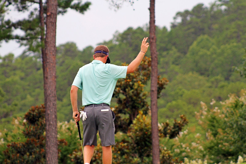 Sean Dale of Jacksonville, FL acknowledges the crowd after sinking a birdie putt during the championship match of the 111th Western Amateur at The Alotian Club in Roland, AR. (WGA Photo/Ian Yelton)