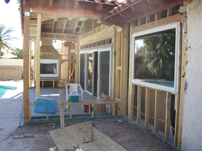 Looking along the back of the house into the patio.
