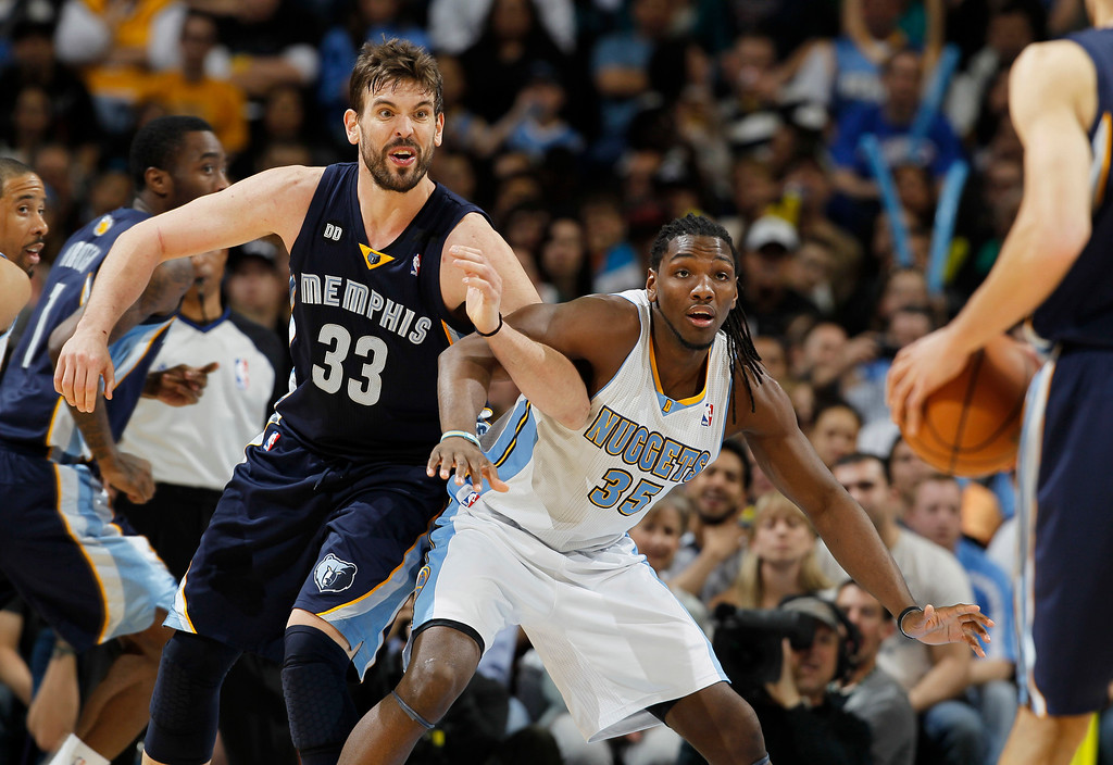 . Memphis Grizzlies center Marc Gasol, left, looks for a pass while working for position with Denver Nuggets forward Kenneth Faried during the third quarter of the Nuggets\' 87-80 victory in an NBA basketball game in Denver on Friday, March 15, 2013. (AP Photo/David Zalubowski)