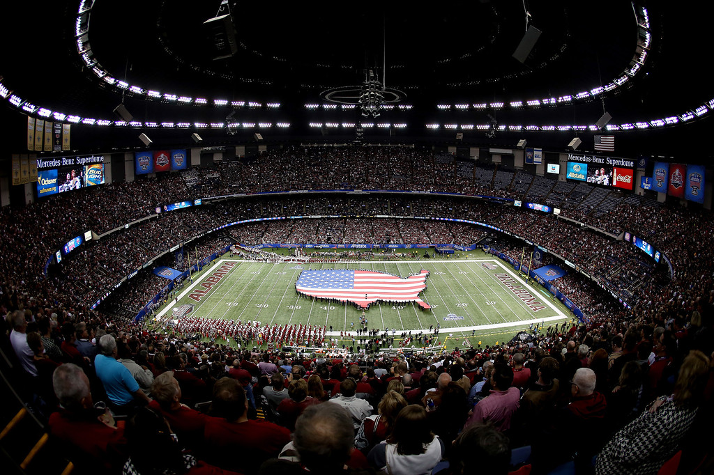 . NEW ORLEANS, LA - JANUARY 02:  Band members hold an American flag before the start of the Allstate Sugar Bowl between the Alabama Crimson Tide and the Oklahoma Sooners at the Mercedes-Benz Superdome on January 2, 2014 in New Orleans, Louisiana.  (Photo by Sean Gardner/Getty Images)