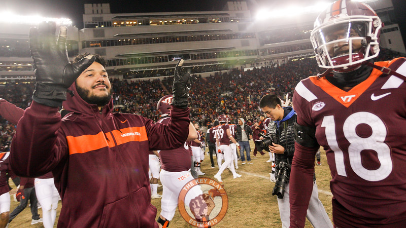 "Injured QB Josh Jackson holds up a ""15"" with his hands towards the UVa sideline. Virginia Tech beat UVa for the 15th year in a row. (Mark Umansky/TheKeyPlay.com)"