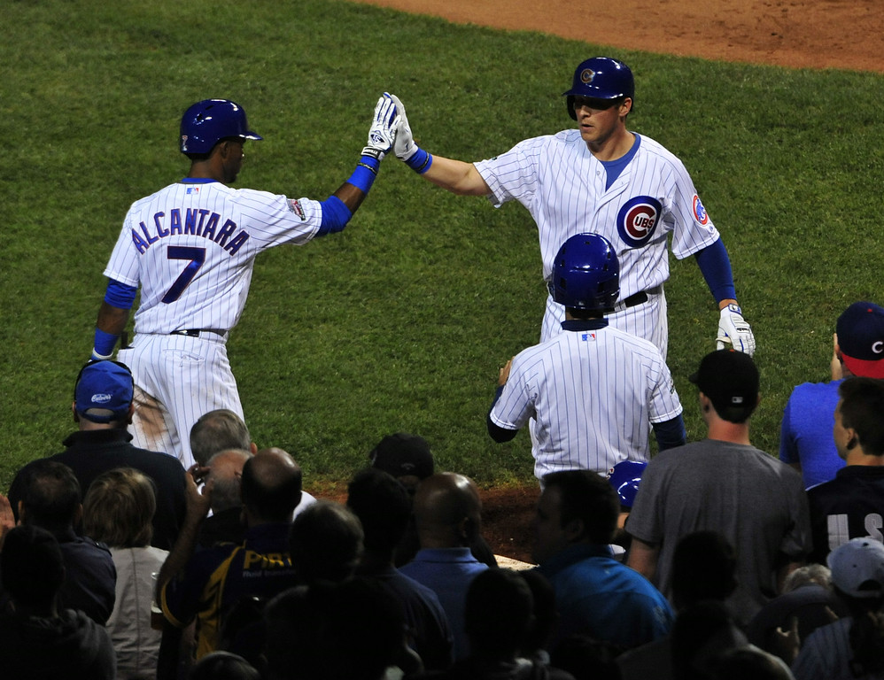 . CHICAGO, IL - JULY 30:  Ryan Sweeney #6 of the Chicago Cubs is greeted by Arismendy Alcantara #7 of the Chicago Cubs after scoring against the Colorado Rockies during the fifth inning on July 30, 2014 at Wrigley Field in Chicago, Illinois.  (Photo by David Banks/Getty Images)