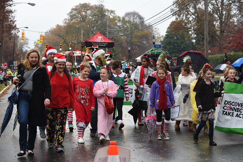 A gaggle of colorfully-clothed parade participants, many sporting Whoville hairdos, braved the rain for this year's event. (Bill Giduz photo)