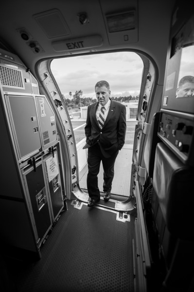 Cal Poly President Jeffrey Armstrong boards the plane to Texas.  Nov. 30, 2012. Ian Billings/Mustang Daily