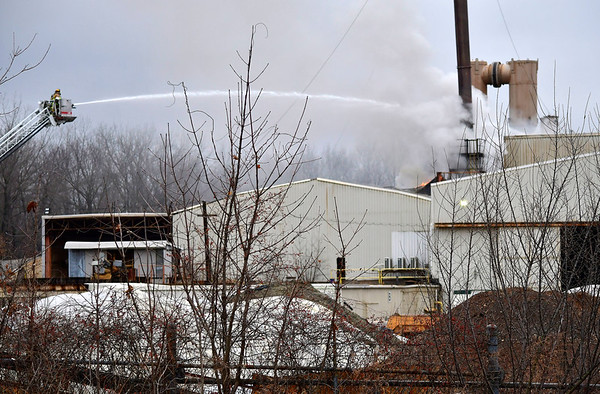 12/31/2019 Mike Orazzi | Staff Plainville, Bristol and Farmington firefighters while extinguishing a factory fire at Clean Earth of Connecticut formerly Phoenix Soil, at 58 North Washington Street shortly after 2 pm on Friday. Firefighters reported over 30 feet of flames coming out of some smoke stacks while responding to the scene.