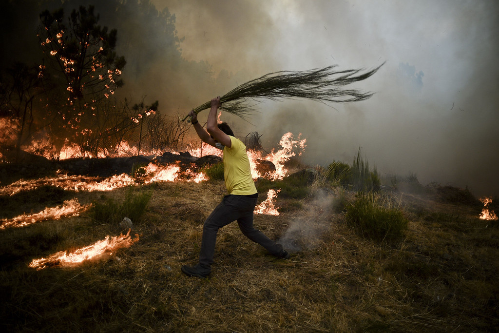 . A local tries to extinguish a wildfire in Caramulo, central Portugal on August 29, 2013.   AFP PHOTO / PATRICIA  DE MELO MOREIRA/AFP/Getty Images