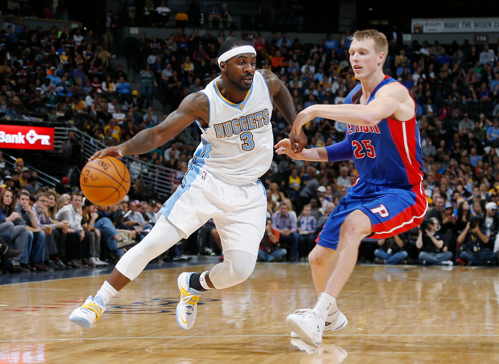 . Denver Nuggets guard Ty Lawson, left, works the ball inside past Detroit Pistons forward Kyle Singler in the third quarter of the Nuggets\' 89-79 victory in an NBA basketball game in Denver on Wednesday, Oct. 29, 2014. (AP Photo/David Zalubowski)