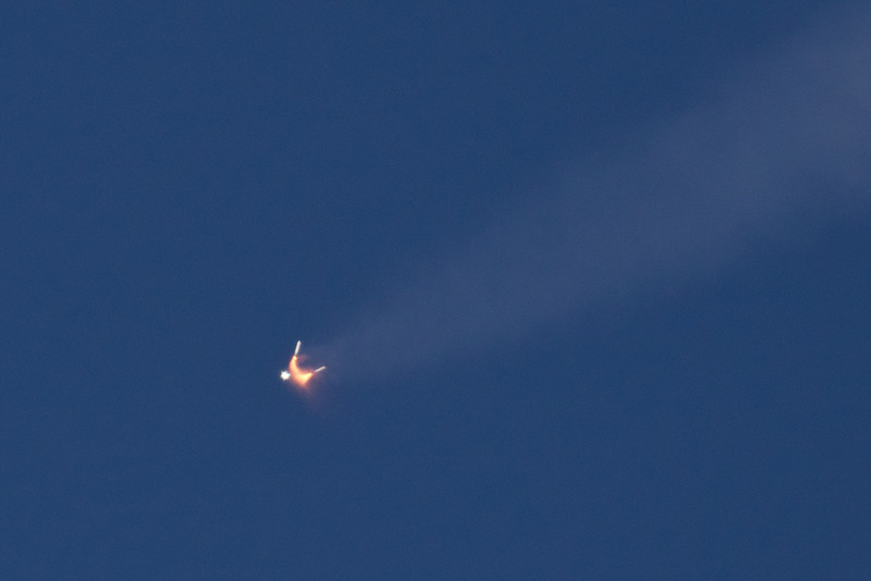 At 2 minutes 3 seconds.  SRB separation at an altitude of about 28 miles.  The white light is the shuttle continuing to burn fuel from the large tank. Down range from KSC= 25.39 miles, Velocity= 3628 miles per hour (Mach 4)