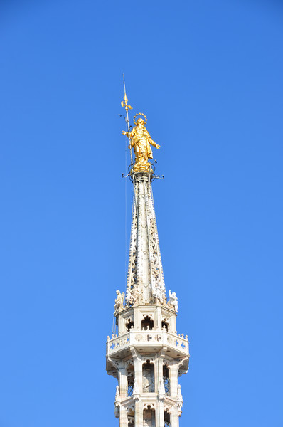 The Virgin Mary (Madonnina) atop Duomo di Milano. Milan