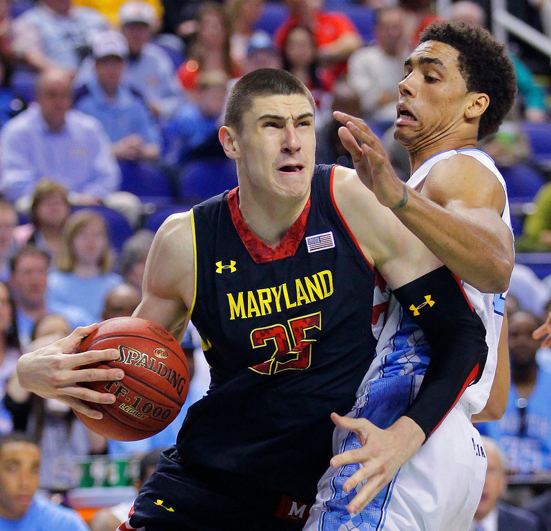 . Maryland\'s Alex Len, left, drives past North Carolina\'s James Michael McAdoo during the first half of an NCAA college basketball game in March, 2013.  Len was picked by the Phoenix Suns during the 2013 NBA Draft. (AP Photo/Bob Leverone, File)