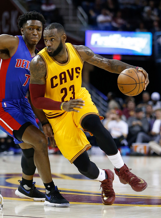 . Cleveland Cavaliers\' LeBron James (23) drives around Detroit Pistons\' Stanley Johnson (7) during the first half of an NBA basketball game Friday, Nov. 18, 2016, in Cleveland. (AP Photo/Ron Schwane)
