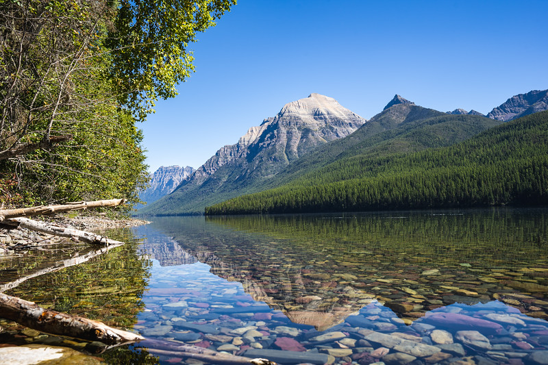Clear Reflection of Mountains in Lake Bowman in Glacier National Park