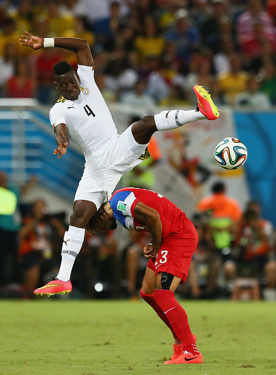 . Daniel Opare of Ghana competes for the ball with Jermaine Jones of the United States during the 2014 FIFA World Cup Brazil Group G match between Ghana and the United States at Estadio das Dunas on June 16, 2014 in Natal, Brazil.  (Photo by Kevin C. Cox/Getty Images)