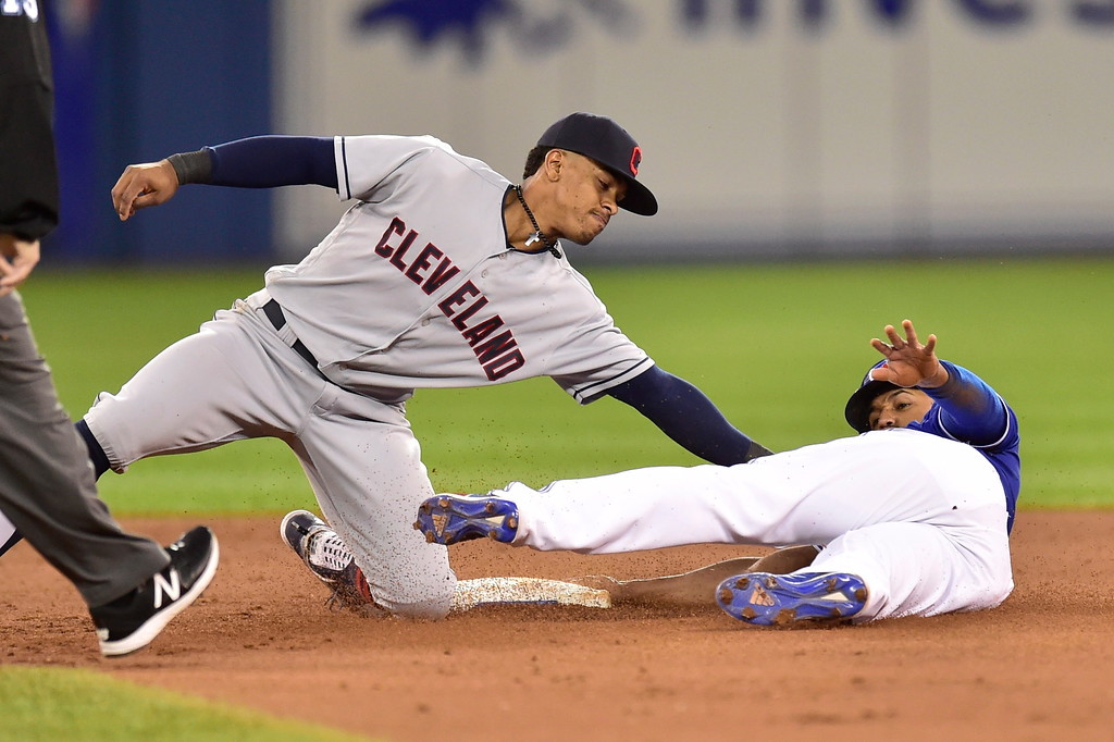 . Cleveland Indians shortstop Francisco Lindor, left, makes the tag as Toronto Blue Jays\' Richard Urena is caught stealing second base during the third inning of a baseball game Friday, Sept. 7, 2018, in Toronto. (Frank Gunn/The Canadian Press via AP)