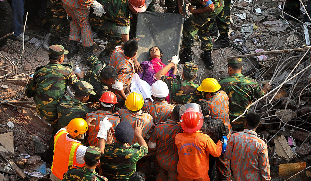 . A survivor lies on a stretcher after being pulled out from the rubble of a building that collapsed in Savar, near Dhaka, Bangladesh, Friday, May 10, 2013. Rescue workers in Bangladesh freed the woman buried for 17 days inside the wreckage of a garment factory building that collapsed, killing more than 1,000 people. Soldiers at the site said her name was Reshma and described her as being in remarkably good shape despite her ordeal. (AP Photo)