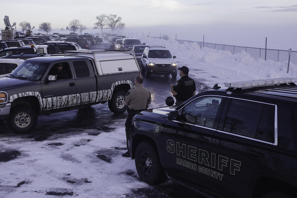 . Marion County Sheriff deputies help park vehicles at the Harney County Fairgrounds ahead of a meeting in Burns, Oregon on January 6, 2016. The meeting was addressing the issues surrounding the takeover of the Malheur National Wildlife Refuge Headquarters by a loose-knit band of farmers, ranchers and survivalists that began January 2, 2016 and attended the public meeting. The leader of a small group of armed activists who have occupied a remote wildlife refuge in Oregon hinted that the standoff may be nearing its end. Speaking to reporters outside the Malheur National Wildlife Refuge, Ammon Bundy said he was aware the occupation that was in its fifth day must end but he added it was too soon to call it quits, Fox news reported. AFP PHOTO/ ROB KERRROB KERR/AFP/Getty Images