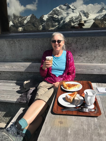Cappuccino, quiche and pecan tart to share after Munt Pers hike & Sheldon's reflection in the window