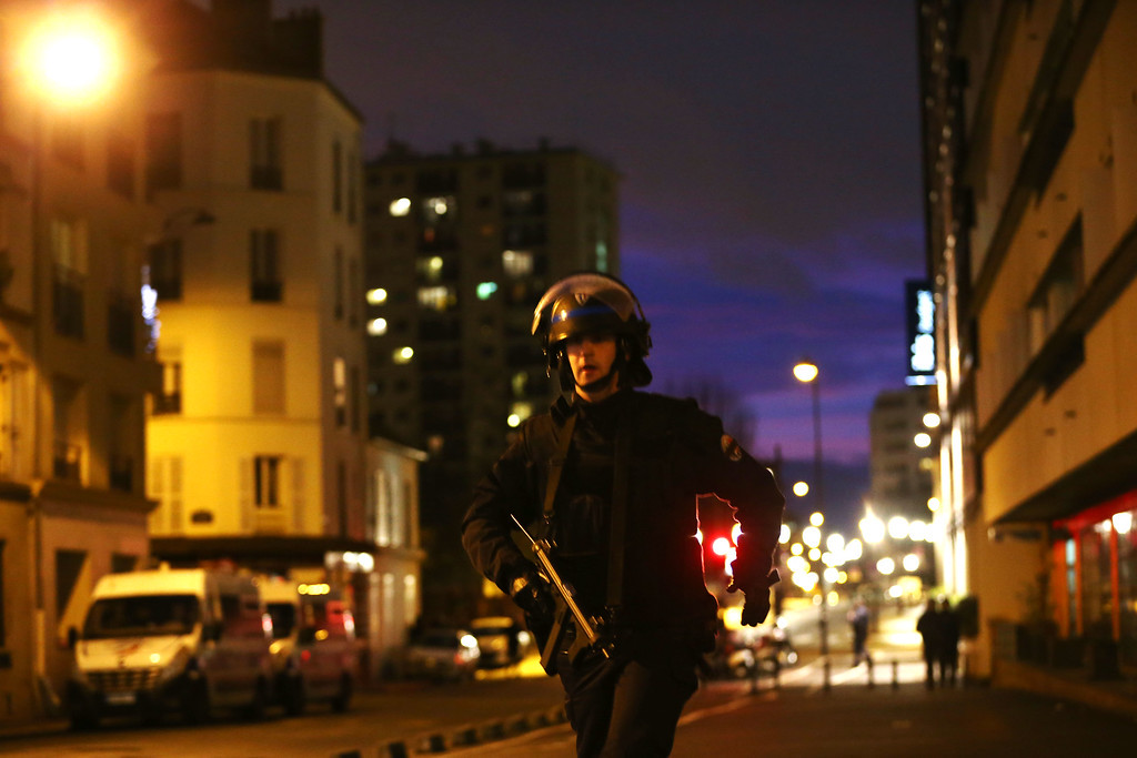 . Police mobilize at the hostage situation at Port de Vincennes on January 9, 2015 in Paris, France. According to reports at least five people have been taken hostage in a kosher deli in the Port de Vincennes area of Paris. A huge manhunt for the two suspected gunmen in Wednesday\'s deadly attack on Charlie Hebdo magazine has entered its third day.  (Photo by Dan Kitwood/Getty Images)