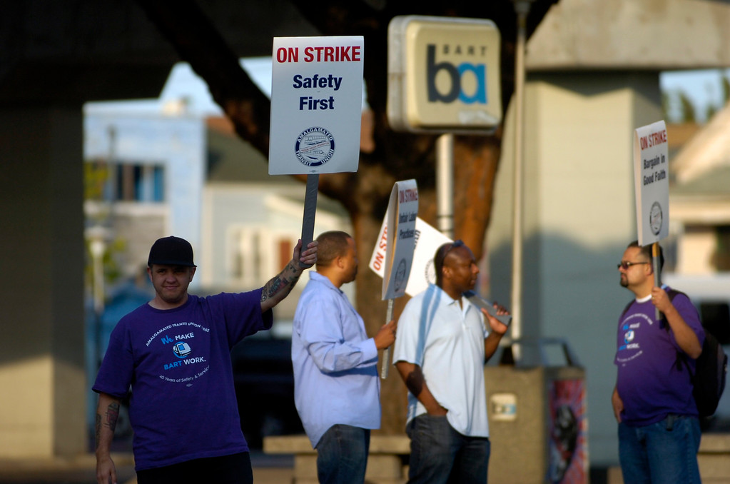 . Union workers walk the picket line at the West Oakland BART station in Oakland, Calif. on Monday, July 1, 2013. (Kristopher Skinner/Bay Area News Group)