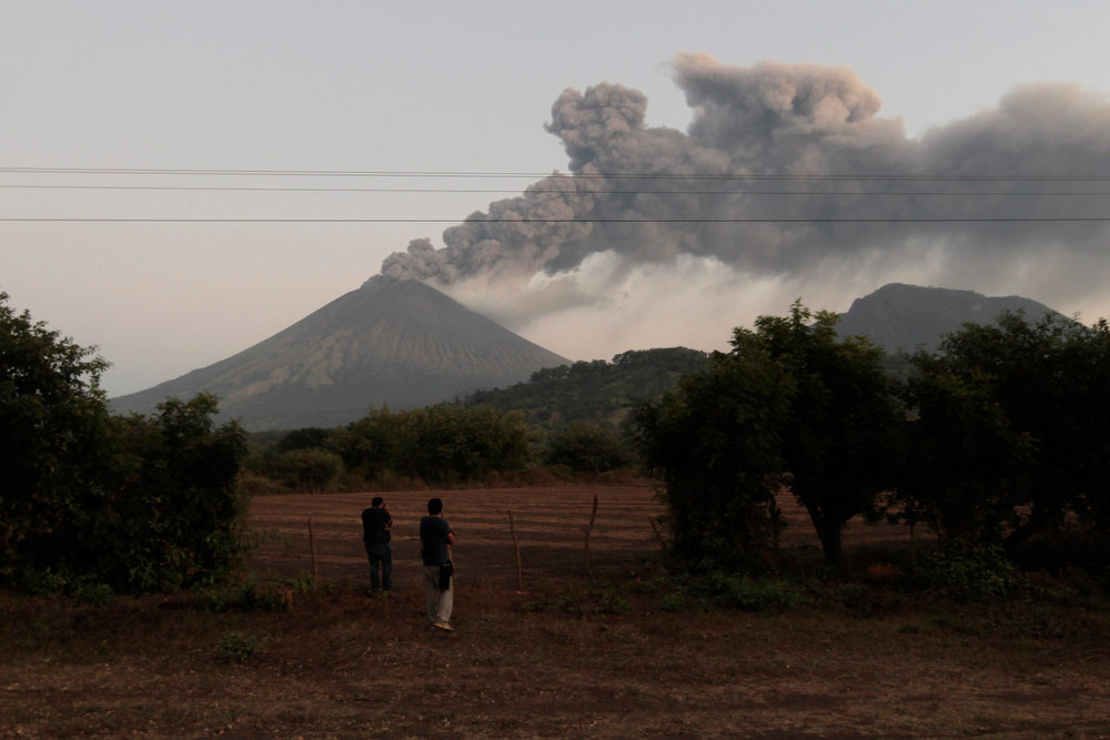 Description of . Photographers take pictures of San Cristobal Volcano at Chinandega city, some 150 km (93 miles) north of the capital Managua December 26, 2012. The 5,725-foot (1,745-meter) San Cristobal volcano, one of the tallest in Nicaragua, has belched an ash cloud hundreds of meters into the sky in the latest bout of sporadic activity, prompting the evacuation of nearby residents, the government said on Wednesday. REUTERS/Oswaldo Rivas