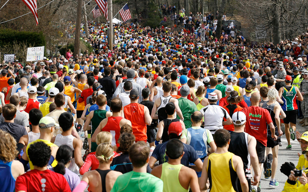 . Runners start the 117th running of the Boston Marathon, in Hopkinton, Mass., Monday, April 15, 2013. (AP Photo/Stew Milne)