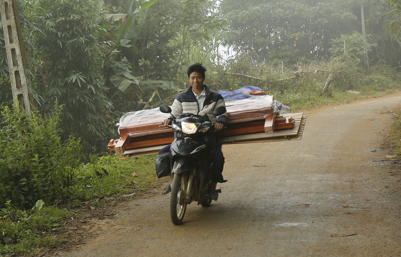 Scooters serve as trucks and transport.